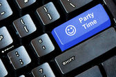 Blue PARTY TIME button on a computer keyboard
