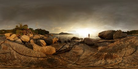 Photo for Spherical, 360 degrees panorama of a rocky coast of Andaman sea near Laem Sing beach at sunset light. Phuket, Thailand - Royalty Free Image