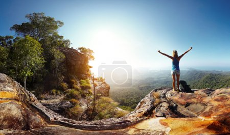 Photo for Hiker with backpack enjoying valley view from top of a mountain - Royalty Free Image
