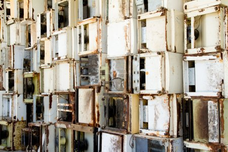 Background of refrigerators in a recycling plant.