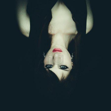 Horror Scene of a Woman Possessed, upside down