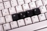 Nápověda pro aplikaci Word napsané s černými klávesami na klávesnici počítače