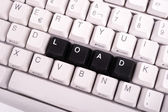 Slovo práce napsané s černými klávesami na klávesnici počítače