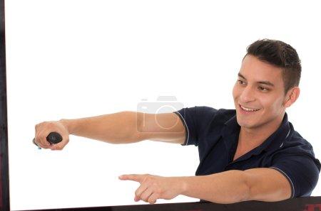 man posing as driving car pointing