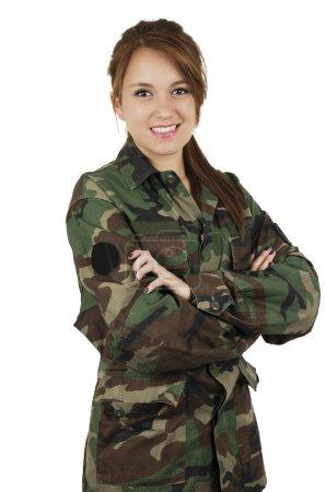 Happy teenage young girl wearing green military ja...