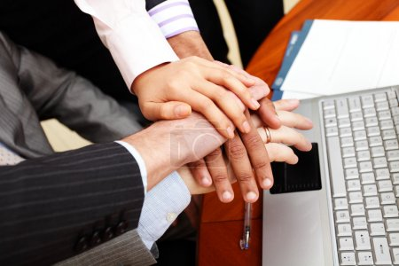 Image of business hands on top of each other.