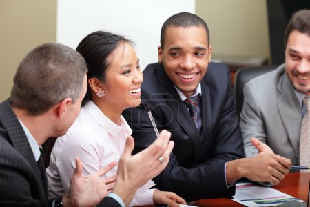 Diverse business group laughing at the meeting