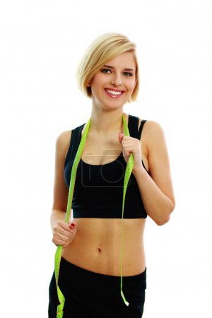 Fit woman with measure tape