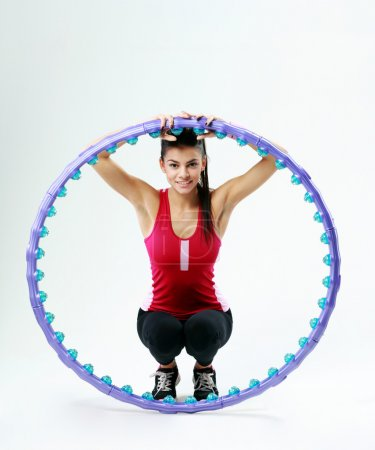 Woman with massage hoop