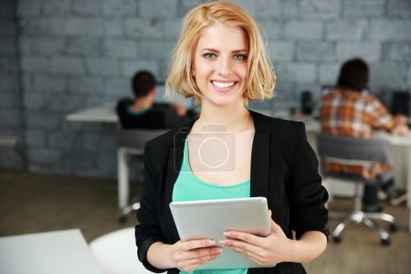 Young beautiful woman in office