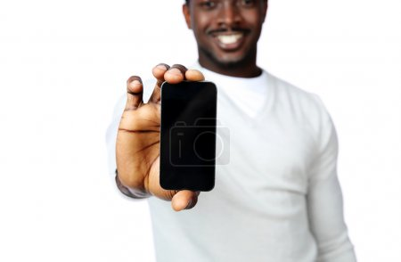 African man showing blank smartphone display