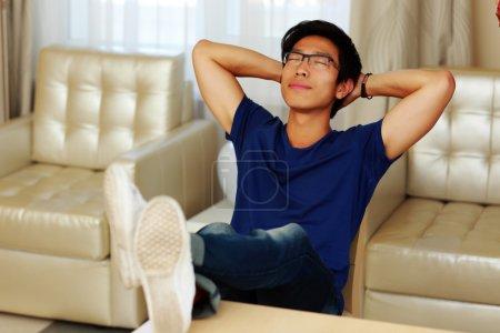 Asian man relaxing at home...