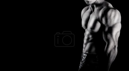 Photo for Bodybuilder showing his muscles. on a black background - Royalty Free Image