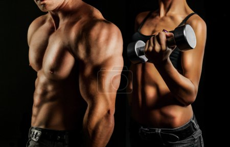 Photo for Bodybuilding. Strong man and a woman posing on a black background - Royalty Free Image