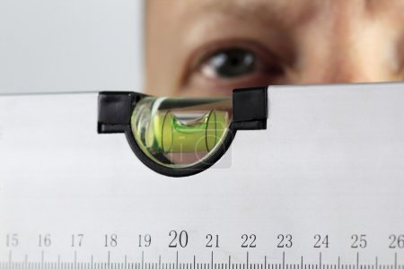 Photo for Male checks spirit level - ensure precise measurement - Royalty Free Image
