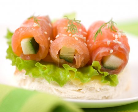 Photo for Rolls of lightly salted salmon with cucumber - Royalty Free Image