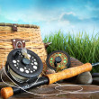 Closeup of fly fishing equipment and basket...