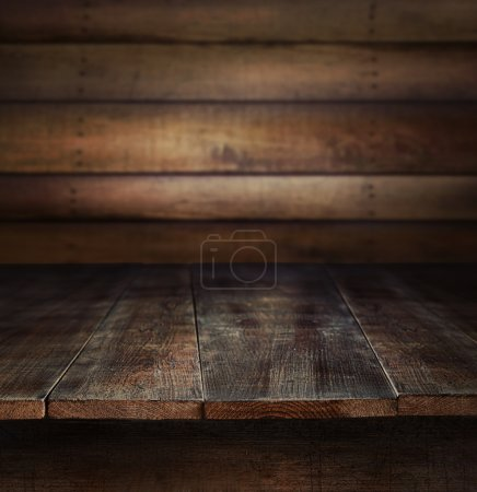 Old wooden table with wooden background...