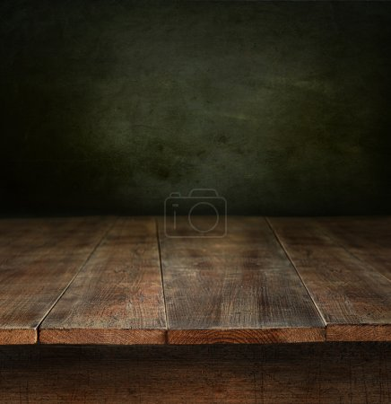 Old wooden table with dark background...