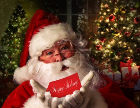 Photo for Santa Claus with festive holiday background - Royalty Free Image