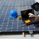 Engineer testing solar panels...