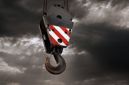 Crane hook on a dramatic sky background