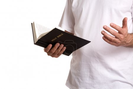 Photo pour Homme avec livre de religion isolé sur fond blanc - image libre de droit