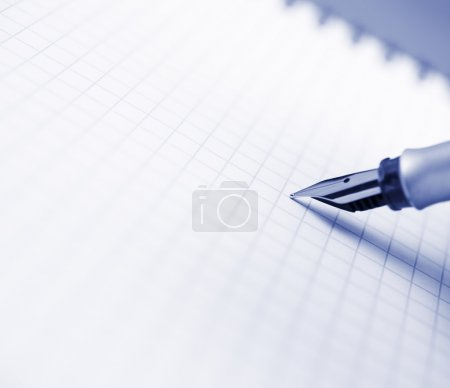 Photo for Fountain pen and notebook, selective focus on center of photo - Royalty Free Image