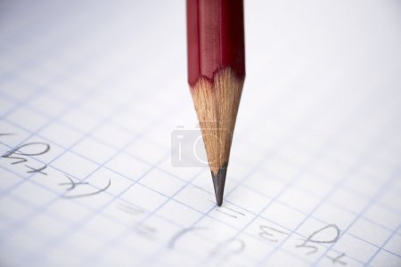 Photo for Writing red pencil in closeup, selective focus on center - Royalty Free Image
