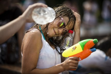 happy young woman with water gun