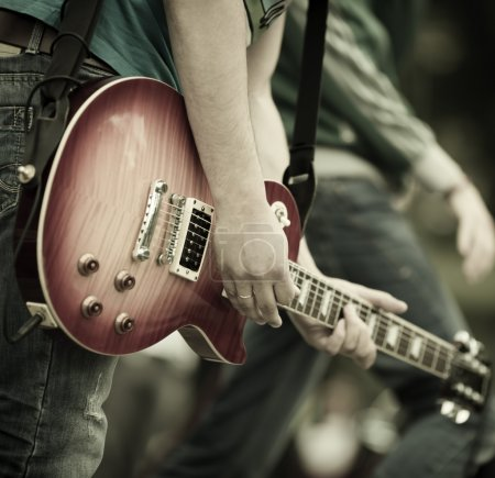 Photo for Play on guitar, selective focus on part of hand and strings - Royalty Free Image