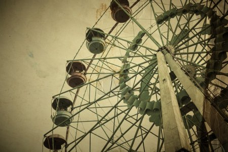 Aged vintage photo of carnival ferris wheel