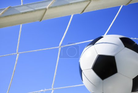 Photo for Soccer ball going into goal net ,selective focus - Royalty Free Image