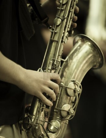 Play the saxophone