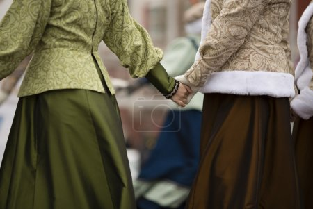 hands of women in traditional russian clothing