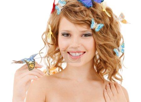 Happy teenage girl with butterflies in hair