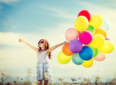 happy girl with colorful balloons