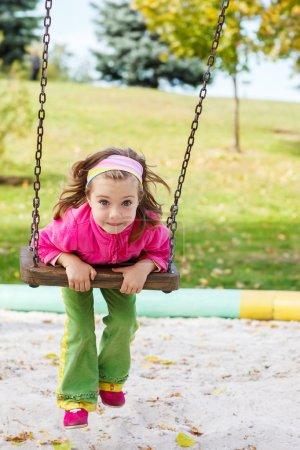 Photo for Beautiful little girl on the swing - Royalty Free Image