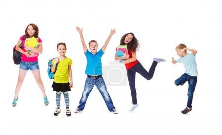 Photo pour Étudiants excités du primaire et du secondaire - image libre de droit