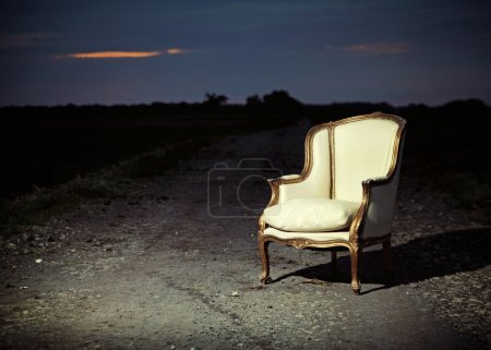 Antique chair let on the road