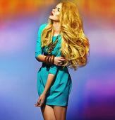 Sensual blonde wearing blue dress