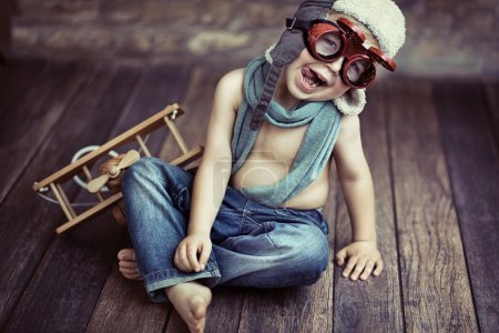 Photo for Picture of small boy playing wooden plane - Royalty Free Image