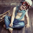 Picture of small boy playing wooden plane...
