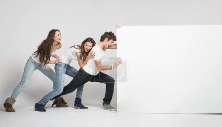 Young pushing white board