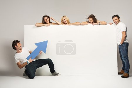Photo for Young with an empty white board - Royalty Free Image