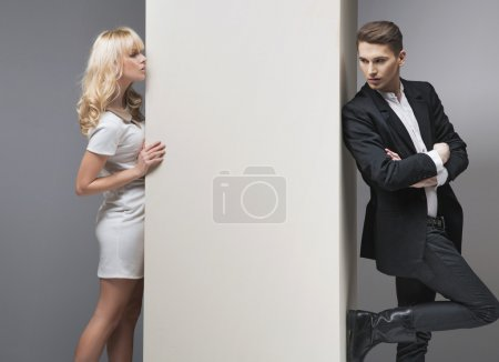 Alluring blonde woman trying to catch her boyfriend