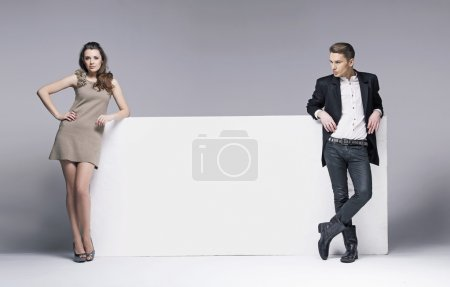 Photo for Nice photo of young attractive couple with white board - Royalty Free Image