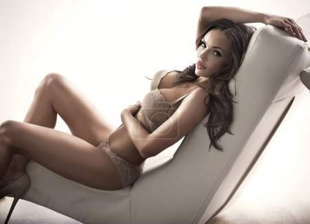 Adorable brunette woman on the couch