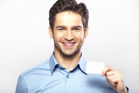 Smiling handsome guy with business card