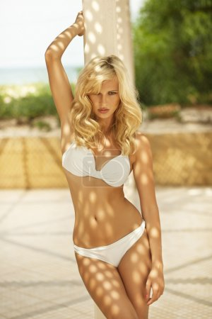 Attractive blonde woman with perfect body